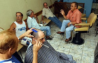 Third place - A barber shop in Brazil. The barber shop is an example of the third place; in many societies it has been a traditional area for (especially) men to congregate separate from work or home.