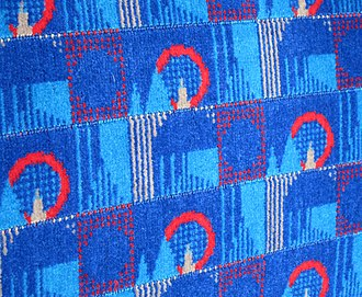 Moquette - A Transport for London moquette seat covering in the 2011 Barman design, named after Christian Barman who commissioned the first moquettes for the London Underground in 1936.