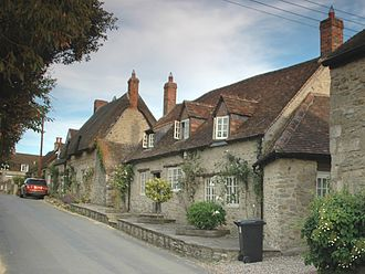 Beckley, Oxfordshire - One and a half storey vernacular cottages in High Road, Beckley. They are built of coursed rubble masonry of local stone, typical of the Great Rebuilding of England.
