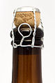 Beer bottle sealed with a cork and muselet.jpg