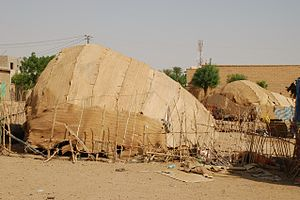 Atbara - Traditional Beja tents alongside modern buildings