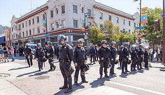 2017 Berkeley protests - Police wearing riot helmets fill the intersection of Bancroft and Telegraph.