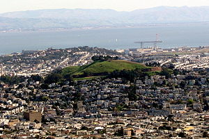 Bernal Heights, San Francisco - Bernal Heights. The Mission District is in the foreground and Hunters Point and the bay are in the background