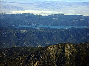 Big Bear Lake - Big Bear Lake in the San Bernardino Mountains, with Lucerne Dry Lake visible in the Mojave Desert beyond, seen from an airliner on approach to Los Angeles.