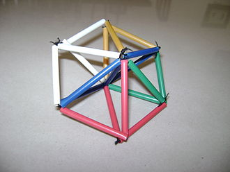 Bipyramid - A bipyramid made with straws and elastics. An extra axial straw is added which doesn't exist in the simple polyhedron