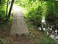 Boardwalk by stream on path between two woods - geograph.org.uk - 498894.jpg