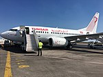 Boeing 737-600 Tunisair TS-IOM Named Carthage in Monastir MIR Airport.jpg