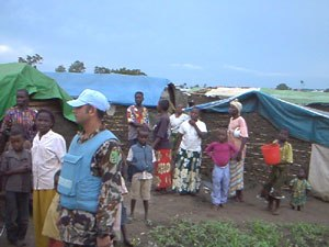 Ituri conflict - Internally displaced refugees in Bunia with MONUC personnel, 2004