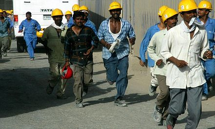 South Asian construction workers at the Burj Khalifa (formerly Burj Dubai) Burj Dubai Construction Workers on 4 June 2007.jpg