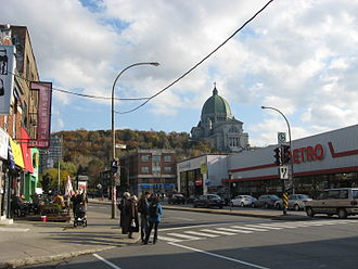 Côte-des-Neiges Road - Côte-des-Neiges Road at Swail Avenue in Côte-des-Neiges, with Saint Joseph's Oratory in the distance and a Metro to the right.