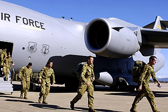 Operation Astute - Australian soldiers disembark from a USAF C-17 at RAAF Base Richmond on 28 May 2006