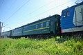 CN passenger train Pekin-Moskva under RZD EP1-143, Circumbaikal railway, Sludyanka. (32356255912).jpg