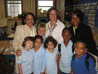 Boston Public Schools - Dr. Carol R. Johnson (back row, far left), former Superintendent of the Boston Public Schools, meets students and their teacher Mrs. McClain and principal at the Bates Elementary School in Roslindale.