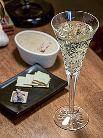 Champagne is often served in specialized stemw...