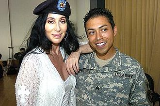 Cher during her July 12, 2006 visit at Landstuhl Regional Medical Center, Germany, which treats injured US military personnel serving in Afghanistan and Iraq Cher at Landstuhl Regional Medical Center 2006.jpg