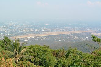 Chiang Mai International Airport - Aerial view of the airport's runways and southern part of the city