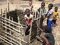 Children building a house (5209200364).jpg