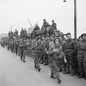 Churchill tanks of 6th Guards Tank Brigade and troops of the 10th Highland Light Infantry, 15th (Scottish) Division, during the assault on Tilburg, Holland, 28 October 1944. B11419.jpg