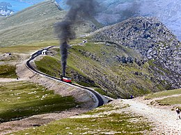 Clogwyn Station with steam train.jpg