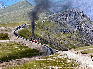 A steam train leaves the Clogwyn crossing station.
