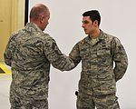 Command chief of ANG coins Airmen 160304-Z-GS745-076.jpg