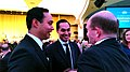 Congressman Joaquin Castro of Texas, left, and his identical twin, Secretary of Housing Julian Castro, chat with Sen. Chris Coons of Delaware at the White House Correspondents Association dinner in Washington, April 30, 2016.jpg
