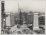 Construction of the northern piers of the Sydney Harbour Bridge, 1927 (8282692805).jpg