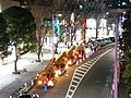 Crane trucks abfut to remove Christmas illuminations from trees, in Keyakizaka.jpg