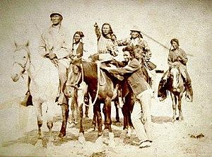 Crow Indians mounted on horseback