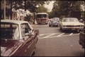 DIAL A RIDE RADIO DISPATCHED DOOR-TO-DOOR BUS MAKES ITS WAY THROUGH TRAFFIC IN HADDONFIELD, NEW JERSEY. DURING RUSH... - NARA - 556753.tif
