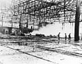 Damaged Midway seaplane hangar 1942.jpg