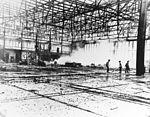 Damaged Midway seaplane hangar 1942.jpg