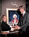 Dame Vera Lynn's daughter Virginia Lewis-Jones and Ross Kolby in front of his portrait of Lynn at the unveiling ceremony at the Royal Albert Hall on 13th January 2020.jpg