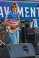 David Smash playing his Schecter guitar ar Venice Chalk festival.jpg