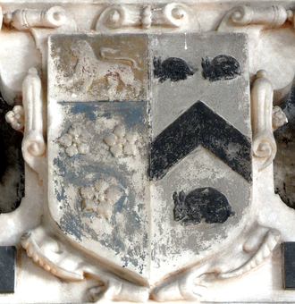 Creedy, Sandford - Arms of Sir John Davie, 1st Baronet (1588–1654) of Creedy: Azure, three cinquefoils or on a chief of the last a lion passant gules impaling: Argent, a chevron between three conies courant sable (Strode of  Newnham). Detail from mural monument to his wife Juliana Strode (died 1627), Sandford Church