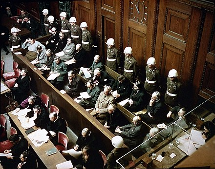 Rare color photo of the trial at Nuremberg, depicting the defendants, guarded by American Military Police Defendants in the dock at nuremberg trials.jpg