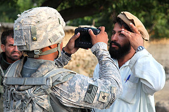 Anthropometry - 2009 photo showing a man having a retinal scan taken by a U.S. Army soldier