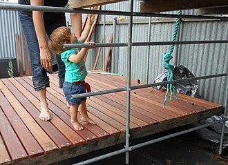 Desire - A toddler having a desire to climb.