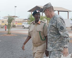 Combined Joint Task Force – Horn of Africa - Maj. Gen. Terry Ferrell, Commander of the Combined Joint Task Force-Horn of Africa, and Gen. Dahir Adan Elmi, Chief of Defense for the Somali Armed Forces, walk together into the galley at Camp Lemonnier, Djibouti (May 2013).