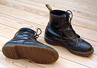 """A pair of """"classic"""" black leather Doc Martens."""