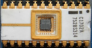 Read-only memory - The first EPROM, an Intel 1702, with the die and wire bonds clearly visible through the erase window.