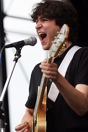 English: Ezra Koenig playing the guitar at the...