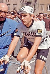 Eddy Merckx on a bike wearing the Peugeot team kit