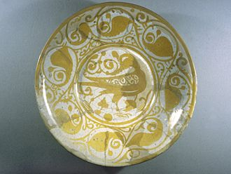 Fustat - Lustreware Plate with Bird Motif, 11th century. Archaeological digs have found many kilns and ceramic fragments in Fustat, and it was likely an important production location for Islamic ceramics during the Fatimid period.