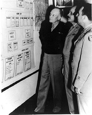 Muir S. Fairchild - From left, Gen Dwight Eisenhower, Army Chief of Staff; Maj Gen Muir Fairchild, AU commander; and Maj Gen David Schlatter, the AU deputy commanding general (education), review an AU organizational chart during General Eisenhower's visit to Maxwell on 9 April 1947.