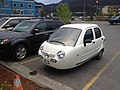 Electric car three wheeler (18025367510).jpg