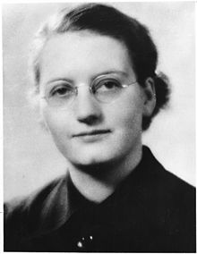 A young woman in glasses