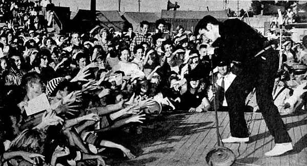 Presley performing live at the Mississippi-Alabama Fairgrounds in Tupelo, September 26, 1956 Elvis Presley - TV Radio Mirror, March 1957 01.jpg
