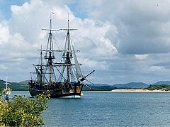 Lieutenant James Cook charted the East coast of Australia on HM Bark Endeavour, claiming the land for Britain in 1770. This replica was built in Fremantle in 1988; photographed in Cooktown harbour where Cook spent 7 weeks.