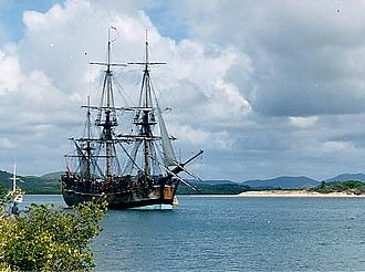 James Cook - Endeavour replica in Cooktown, Queensland harbour – anchored where the original Endeavour was beached for seven weeks in 1770